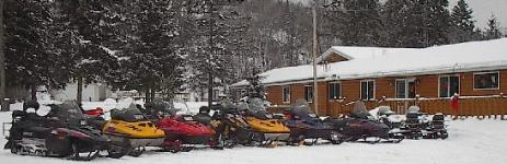 Sleds piling up in the parking lot for a rest